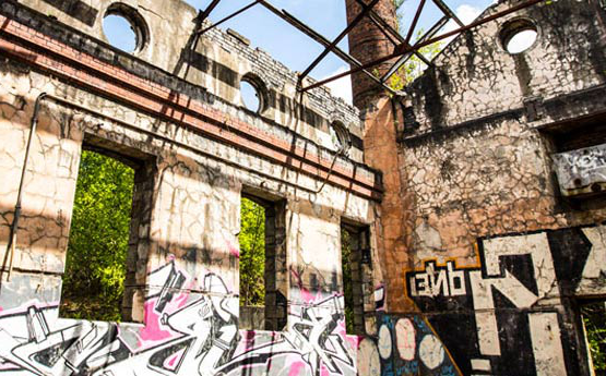 Derelict building with bright graffiti